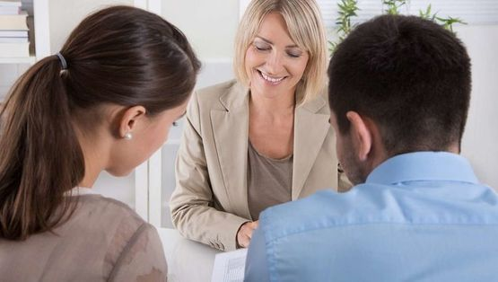 Clients Meeting With A Property Sales Expert